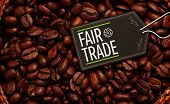 image of extreme close-up  - fair trade against close up of a basket full of dark coffee beans - JPG