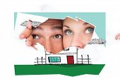 foto of peek  - Young couple peeking through torn paper against white background with vignette - JPG