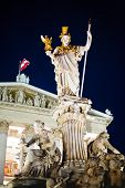 stock photo of goddess  - Night view of Parliament building in Vienna - JPG