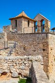 picture of yellow castle  - Medieval castle exterior ancient Calafell town Spain - JPG