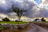 foto of stone house  - Irish country house with road - JPG