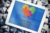 image of autism  - autism awareness month against tablet pc with blue screen - JPG