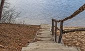 picture of stairway  - Old wooden stairway leads to the lake - JPG