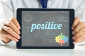 stock photo of autism  - The word positive and autism awareness jigsaw against medical biology interface in blue - JPG