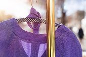 stock photo of thrift store  - pullover hanging on a wardrobe rail on a flea market - JPG