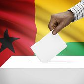 foto of guinea  - Ballot box with flag on background  - JPG