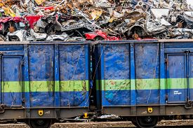 foto of scrap-iron  - old cars were scrapped in a trash compactor - JPG