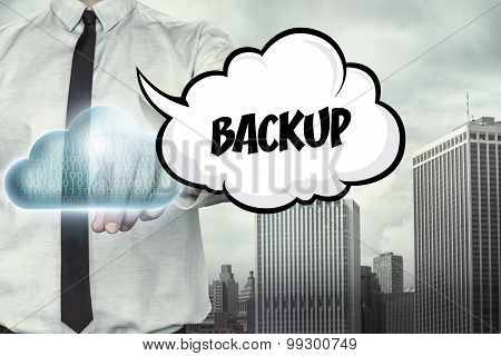 Backup text on cloud computing theme with businessman