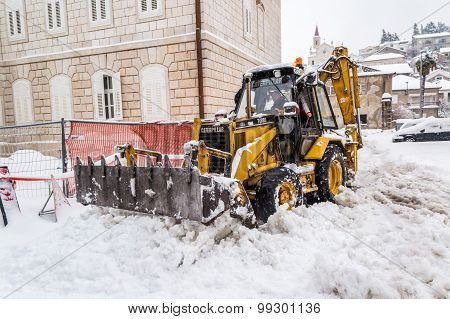 Metkovic, Croatia - February 4: Excavator Cleans The Streets Of Large Amounts Of Snow In Metkovic, C