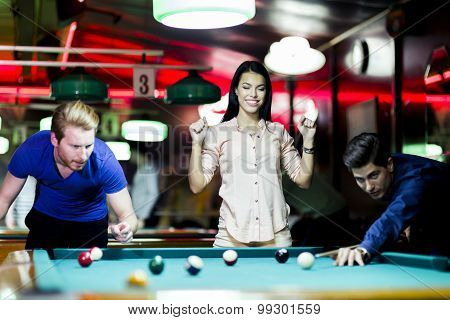 Young People Playing Snooker In A Club Pub Bar