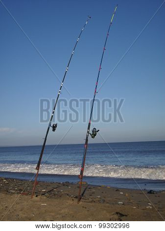 Shingle and sand beach with two fishing rods