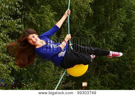 girl in amusement park on cable railway attraction
