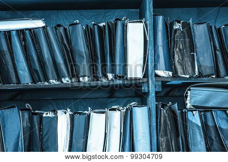 Paper Documents Stacked On Shelf