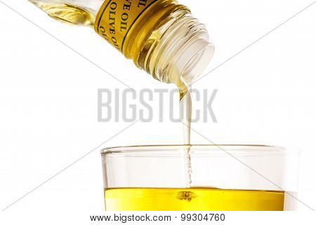 Pouring Olive Oil From Bottle
