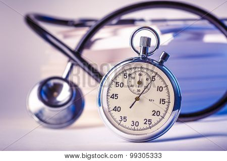 Cards, Stethoscope And Stopwatch