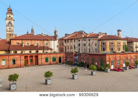 Bell tower among old houses in small town of racconigi in Piedmont, Italy.