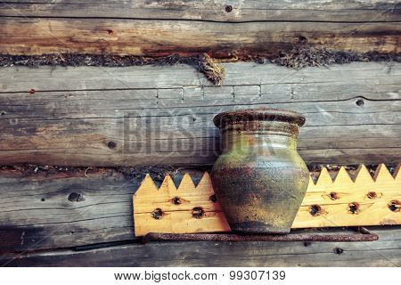 Old Clay Jug On Wooden Background