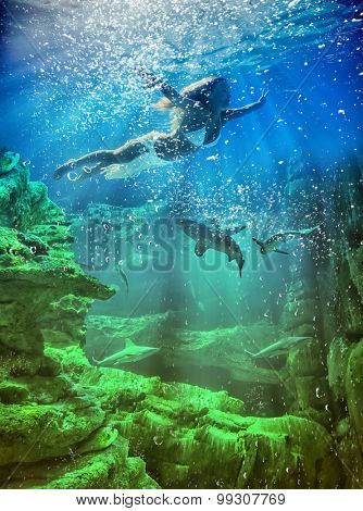 Young blonde woman underwater in the sea