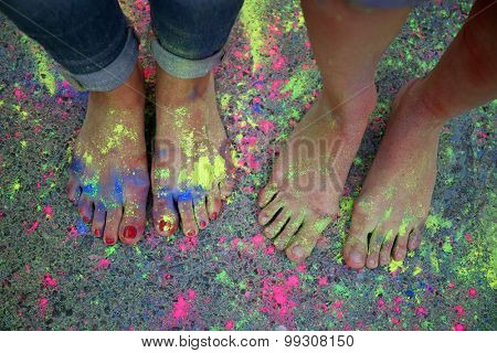 Female legs with Indian dyes on Holi color festival