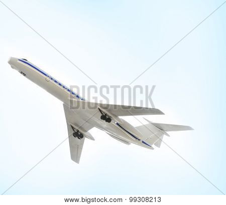Model of plane over blue sky background