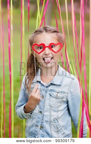 little girl with funny paper glasses