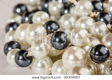 String Of Black And White Pearls