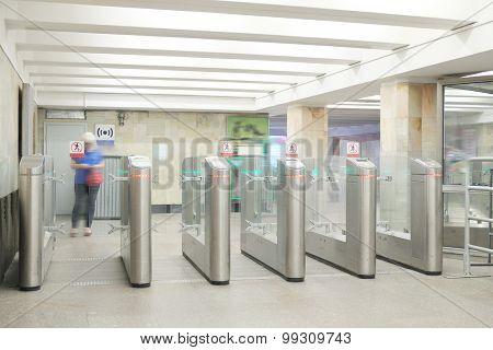 The image of turnstile at a railway vestibule