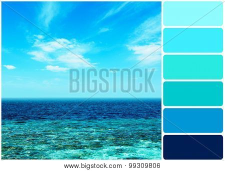 Ocean water above blue sky background and palette of colors