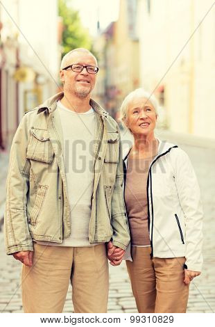family, age, tourism, travel and people concept - senior couple on city street