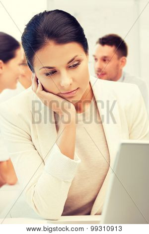 business and communication concept - businesswoman with laptop computer at work