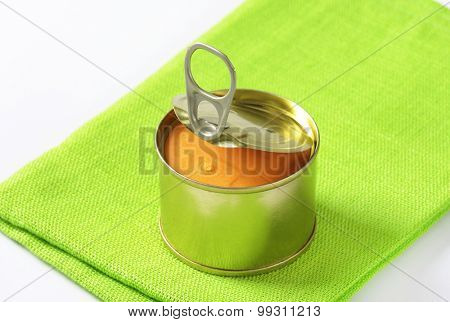 canned pate on folded green cloth