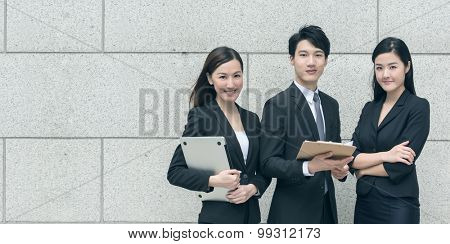 Successful business man with his young team partner in Hong Kong.