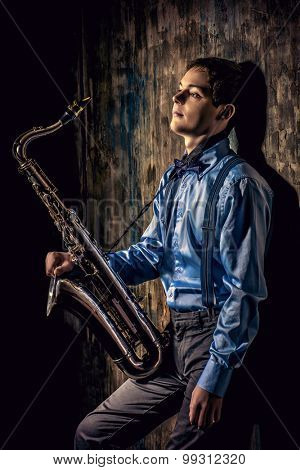 Portrait of a musician with his saxophone. Art and music. Jazz music.