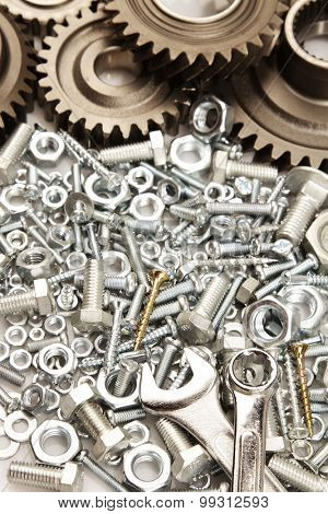 Steel gears, nuts, bolts, and wrenches