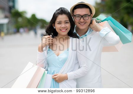 Couple With Paper Bags