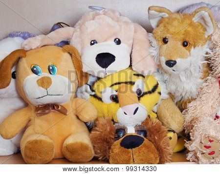 Stuffed soft animal toys waiting for a child to play