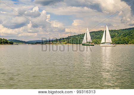 Sailboats on Solina lake in Bieszczady mountains, Poland