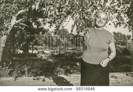 Vintage photo of woman in garden, 1950's