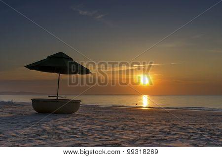 Beach umbrella and sunrise