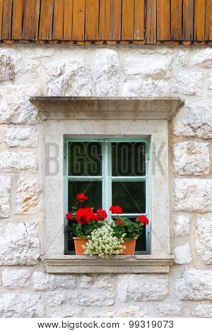Traditional alpine stone window.