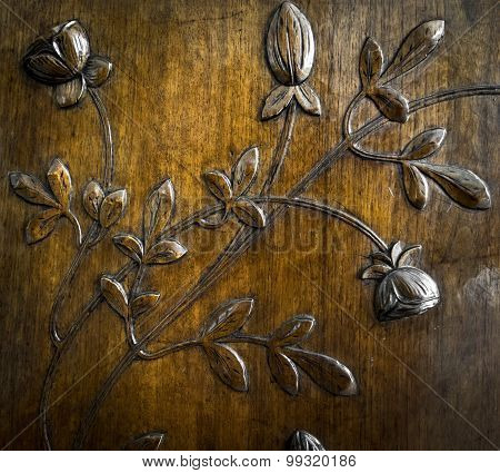 Leaves And Flowers Carved In The Wood