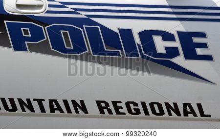 American Police Sign On A Car
