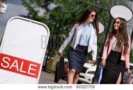 Two asian girl walking with shopping bags