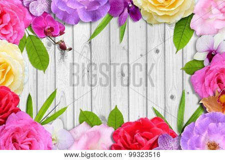 Beautiful flower blossom and leaf frame on white wood background