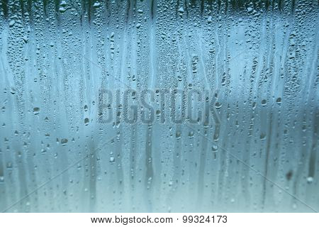 Fogged up glass with many drops
