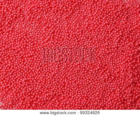 Red sprinkles background