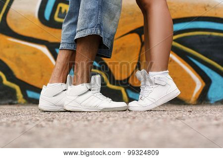Couple In Love. Shoes Close Up. White Shoes On The Asphalt.