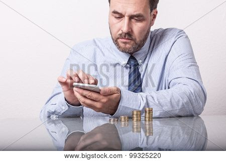 Business man typing on smart phone
