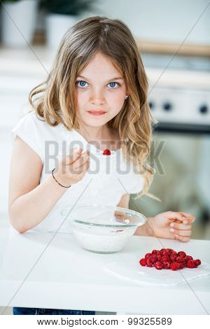Young Girl Eating Muesli With Raspberries
