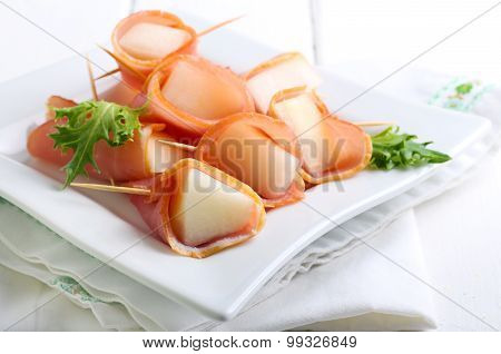 Slices Of Melon Wrapped With Ham